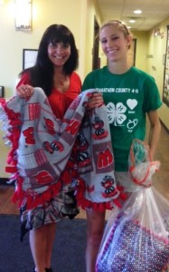 Allison Brunner from the 4-H Rib Mountaineers donating hand-made blankets