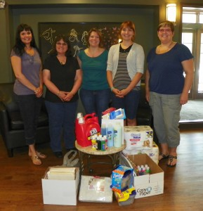 Cloverbelt Credit Union donation of Wish List items; CCU staff shown Jill Luczaj