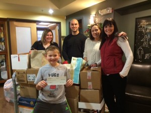 Donation of Wish List items by Rothschild Elementary, with representative Eli Irwin