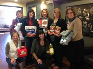 Liberty Mutual staff with donation of household items