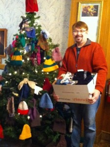 Reverend Phillip Schneider of Saint Paul's United Church of Christ; the congregation donated hand-knit hats, mittens, scarves & booties