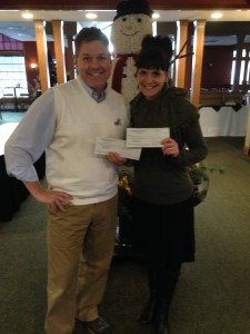 Scott Sann of Greenwood Hills Country Club presenting checks from their Make A Difference Monday fundraisers