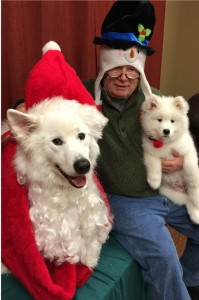 Todd Orthmann and his dogs at The Women's Community Holiday Open House; kids attending got their photos taken with the dogs