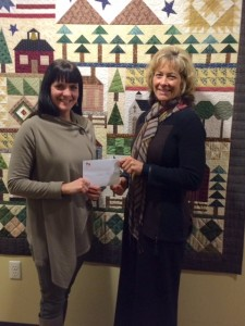 WPS Employees donation, with representative Kelly Zagrzebski